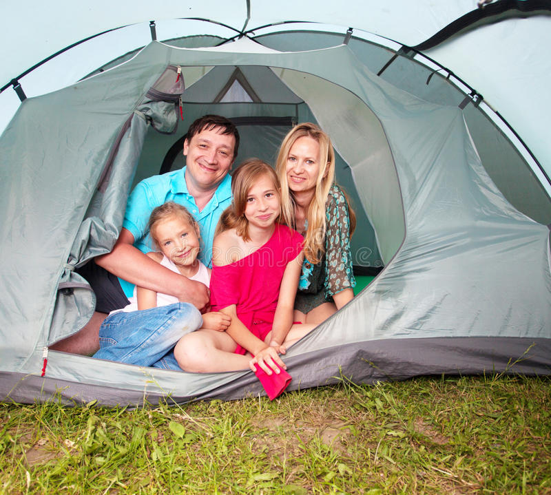 Camping. Family with children in a tent. Camping. Happy parents with kids at summer vacations stock photography