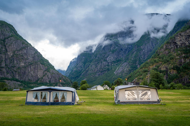 Download C&ing Field With C&er Tents Under The Rocky Mountains Of Norwegian Fjord. Stock Photo & Camping Field With Camper Tents Under The Rocky Mountains Of ...