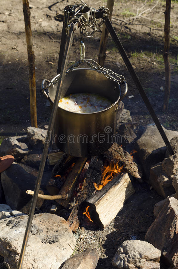 Camping fire with casserole royalty free stock photo