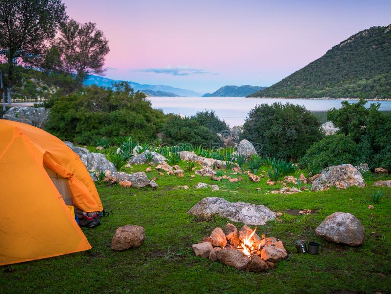 Camping with fire and tent at night on Lycian Way stock image