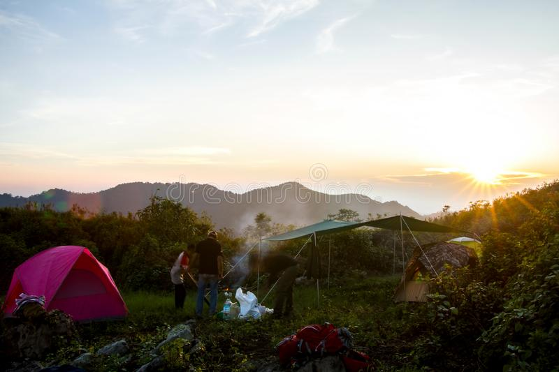 Camping fire under sky sunset with Mountain and clouds. Travel r stock image
