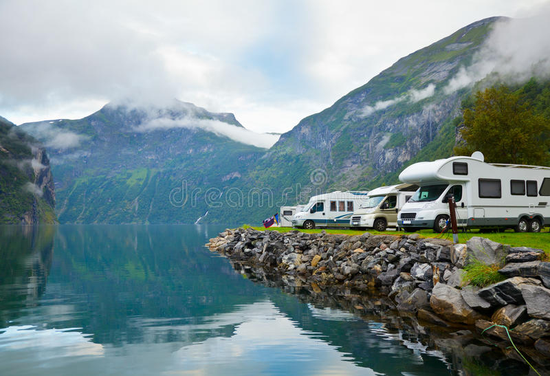 Camping by fjord. Motorhomes at campsite by the Geirangerfjord in Norway royalty free stock images