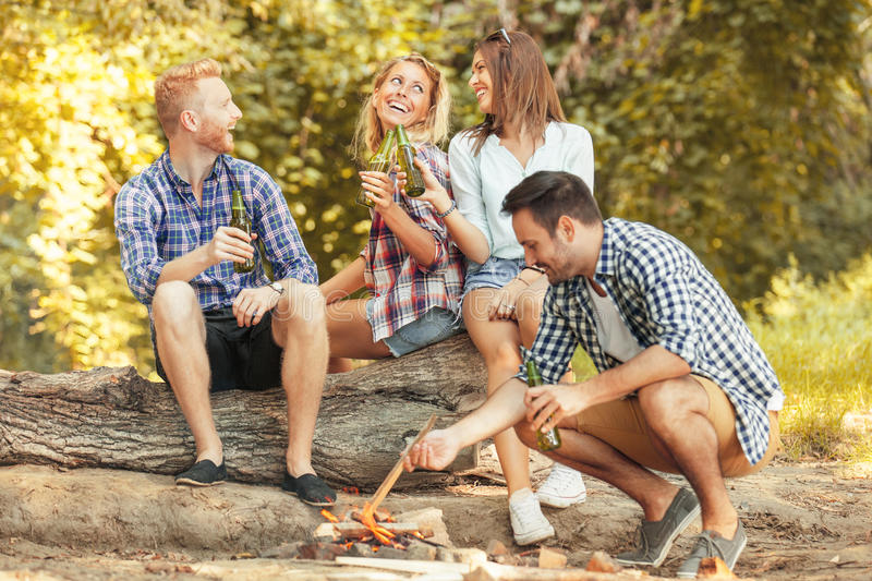 Camping. Friends enjoying camping and grilling stock photography