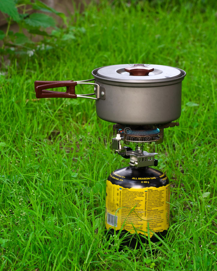 Camping gas-stove. Outdoor on grass royalty free stock photos