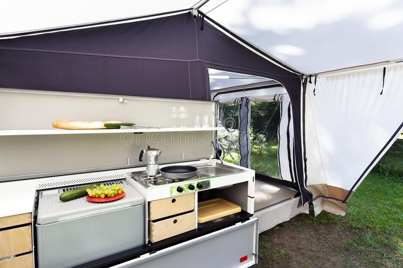 Camping or glamping kitchen. Camping or glamping with a kitchen in a tent stock photos