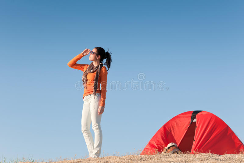 Camping happy woman outside tent on beach royalty free stock photos