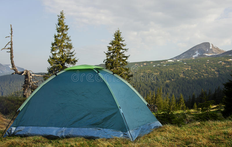 Camping in high mountains, spring begins.  stock images