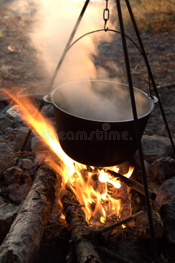 Camping kettle over the fire royalty free stock images