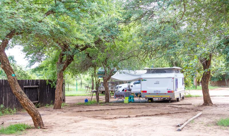 Camping in the Kruger Park in South Africa. Komatipoort, South Africa - January 20, 2020: Caravan camping in the Kruger National Park is a popular South African stock photography