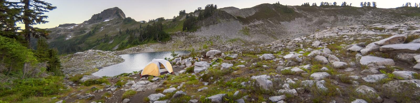 Camping at Lake Ann in the Mt. Baker National Forest, Washington. Tent camping at the foot of the majestic Mt. Shuksan and the lower Curtis Glacier during a stock photos