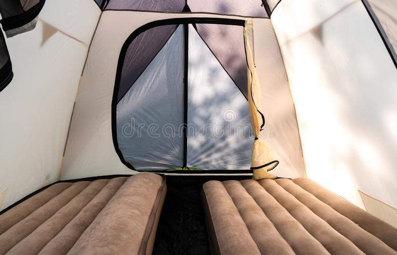 Camping with a large camping tent with inflatable mattresses. stock image