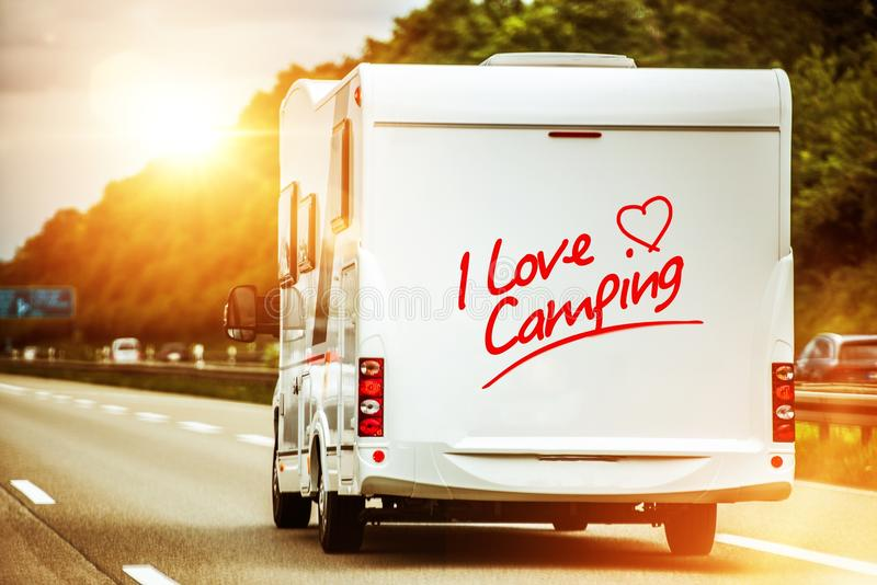 Camping Lover in the Camper. Van on the Route to Summer Vacation Destination royalty free stock image