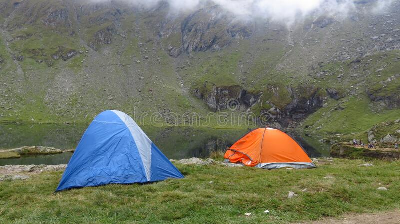 Camping at a Mountain Lake in a Misty Landscape royalty free stock photo
