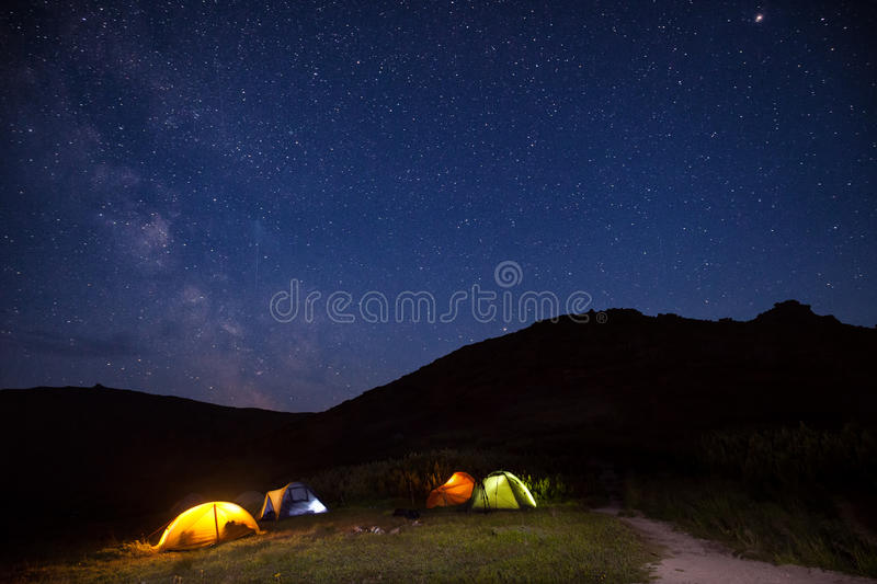 Camping. At the mountains under the stars royalty free stock images