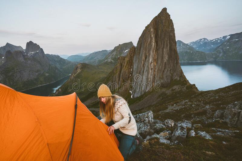 Camping in mountains woman with tent in Norway royalty free stock photography