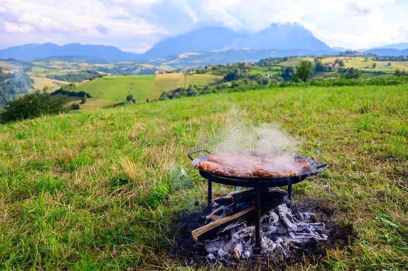 Camping in nature, preparing food on traditional barbecue  , summer vacation royalty free stock photo