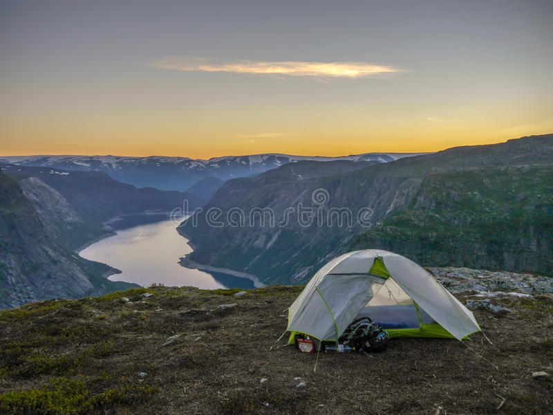 Camping near Trolltunga, Troll's tongue during sunset, Norway royalty free stock photo