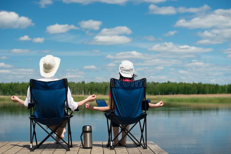 Camping on the river with a loved one. Fishing royalty free stock photos