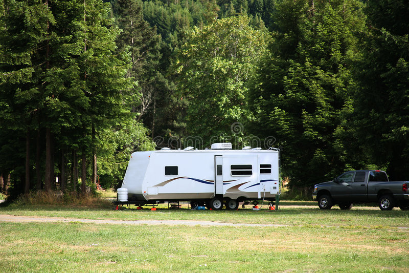 Camping with RV Trailer stock image