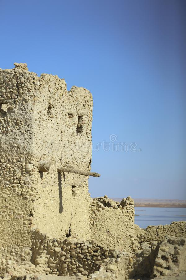 Blue skey siwa island old house remains royalty free stock photo