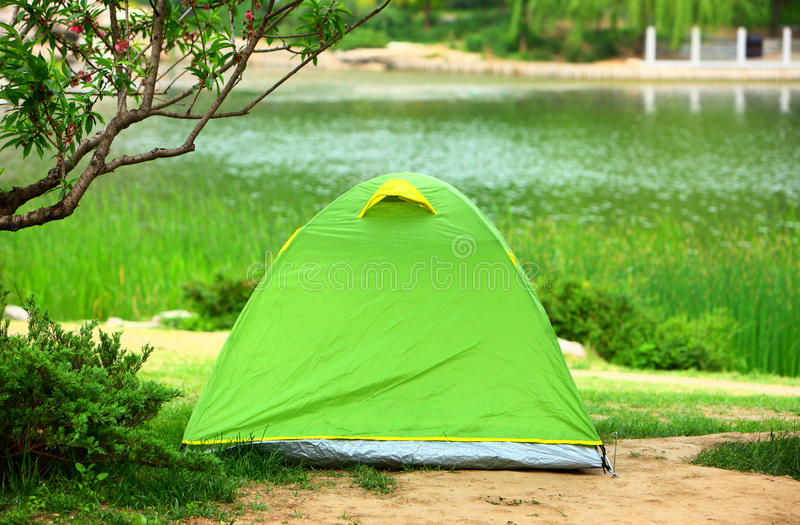 Camping tent. The camping tent nearby the lake in the park royalty free stock photo