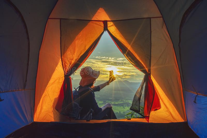 Camping tent at the mountain with sunset royalty free stock photography