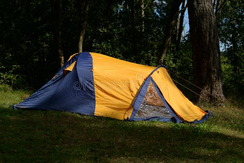 Camping tent in forest stock photos