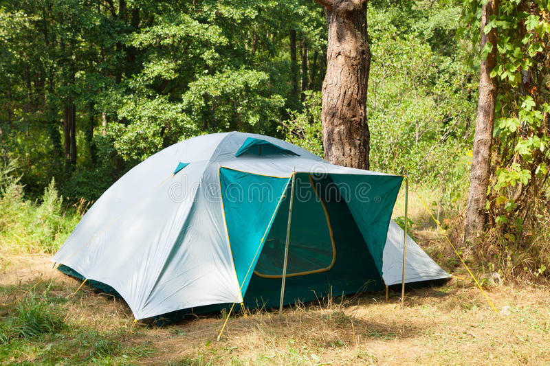 Camping tent in forest. Camping tent in summer forest royalty free stock photos