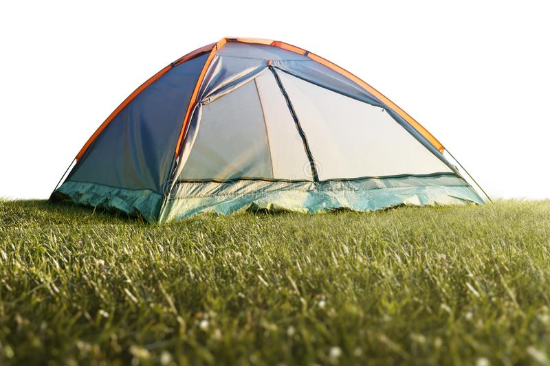 Camping tent in grass isolated on a white background. Isoiated stock photography