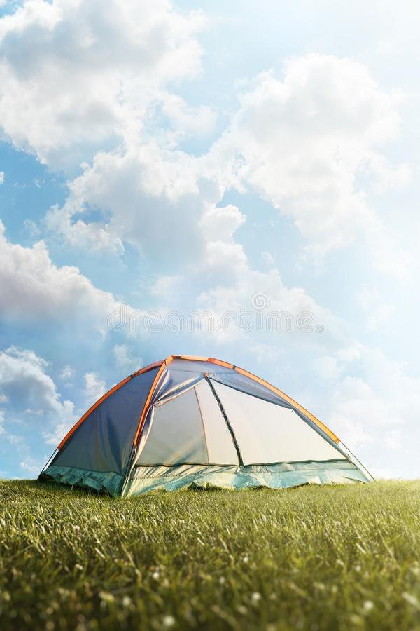 Camping tent in grass. Tourism. Adventure. Hike. Background royalty free stock image