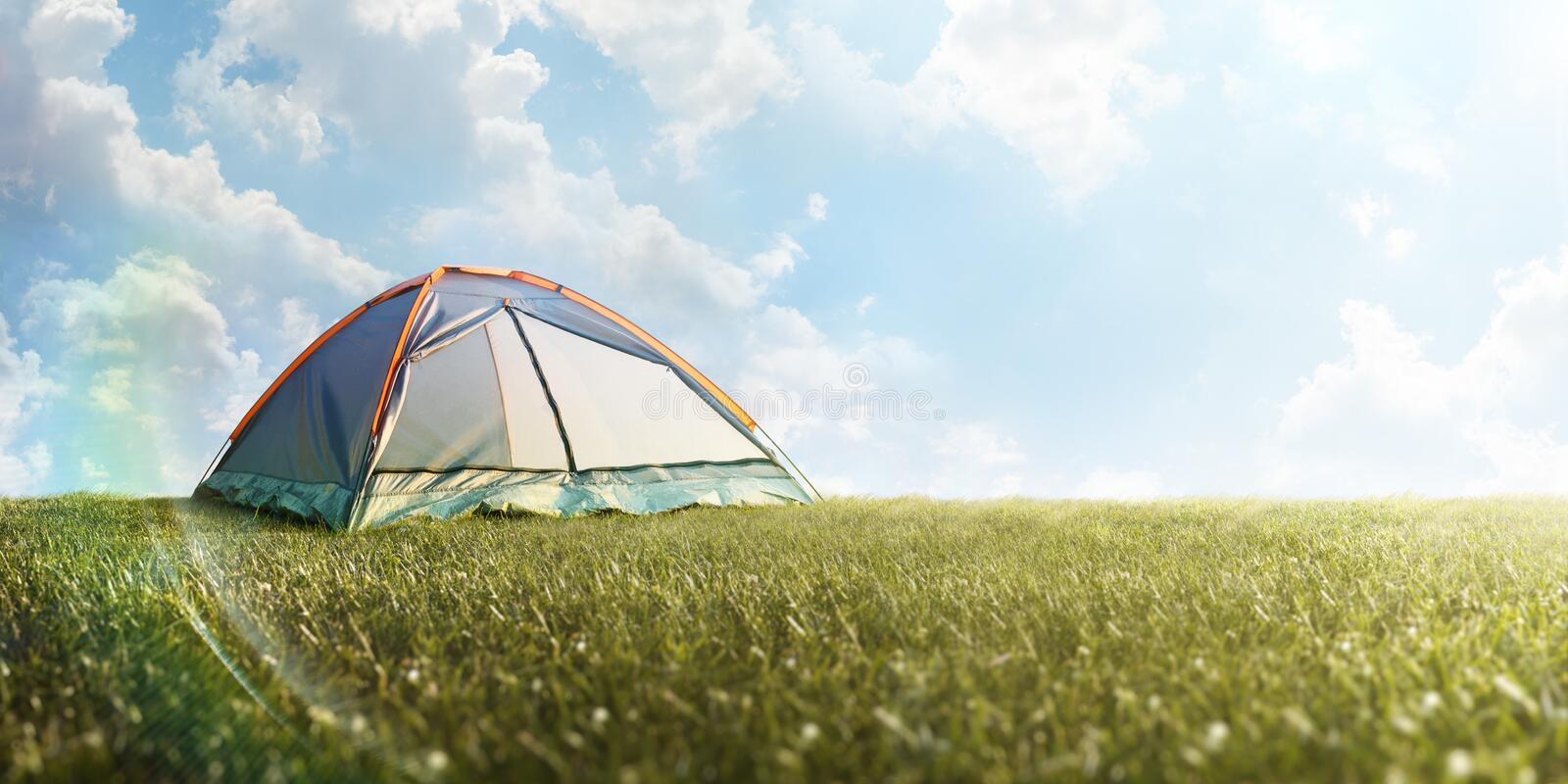 Camping tent in grass. Tourism. Adventure. Hike. Background. Panorama royalty free stock photos