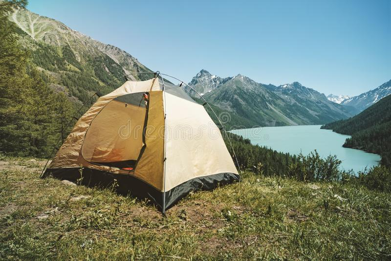 Beautiful mountain landscape in the Altai mountains. Lake kucherlinskoe. Siberia. Russia. Camping tent with lake background. Beautiful mountain landscape in the royalty free stock photography