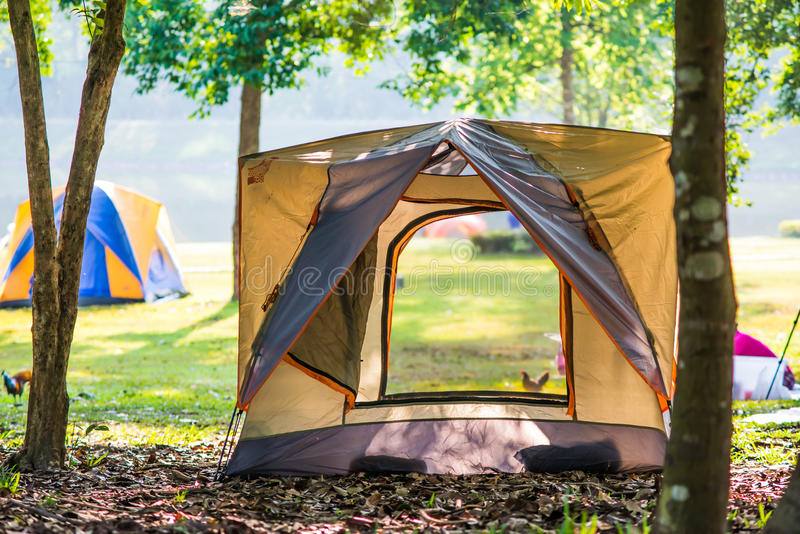 Camping Tent by Lake Forest Chet Khot. Camping Tent by Lake Forest Chet Khot bulging piece of stone used as stove stock images