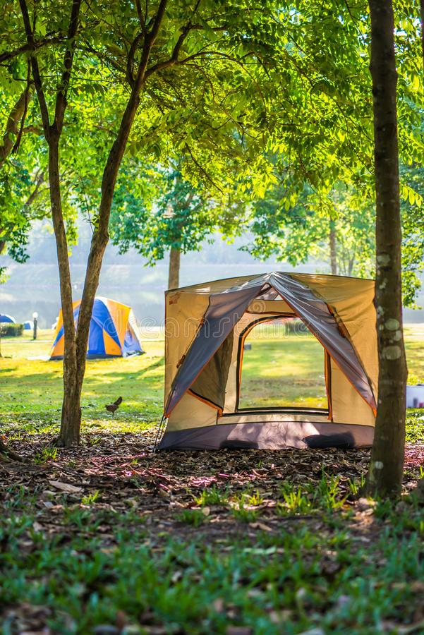 Camping Tent by Lake Forest Chet Khot. Camping Tent by Lake Forest Chet Khot bulging piece of stone used as stove stock photos