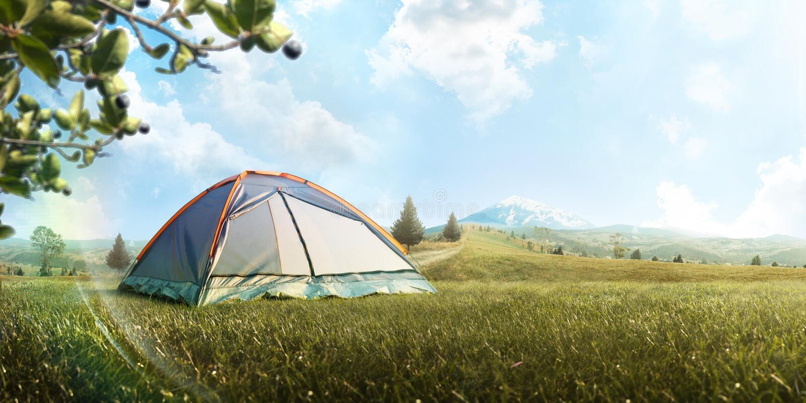The Camping Tent in mountain in the summer. Tourism. Adventure. Hike. Background. Panorama stock photo