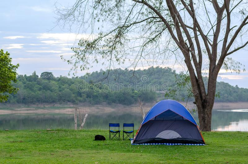 Camping Tent near mountain river in the evening, Kaeng Krachan Dam, Thailand royalty free stock image