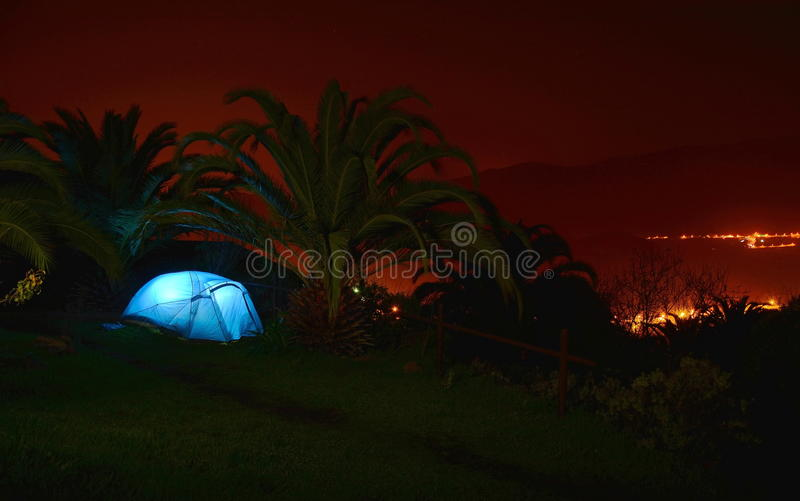 Camping tent in the night under palmtrees royalty free stock image