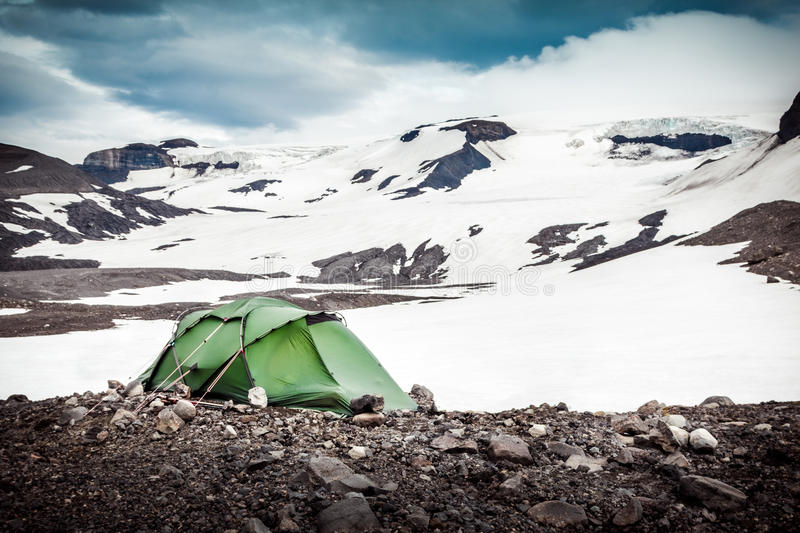 Camping with tent. Snowy mountain glaciers and storm wind. Iceland royalty free stock photos