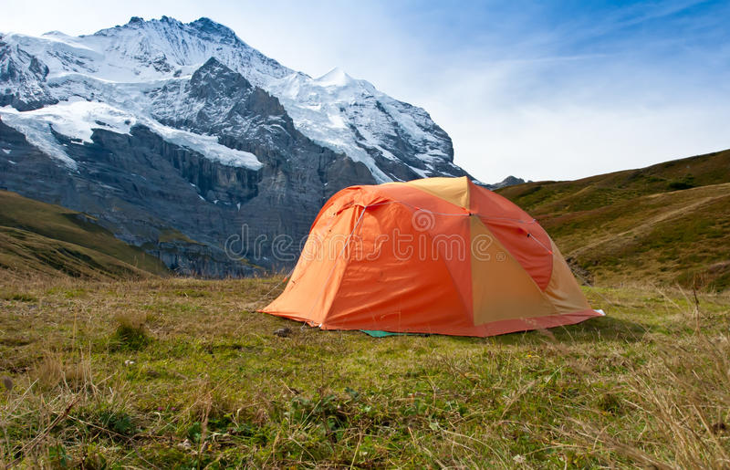 Camping tent in swiss alps stock images
