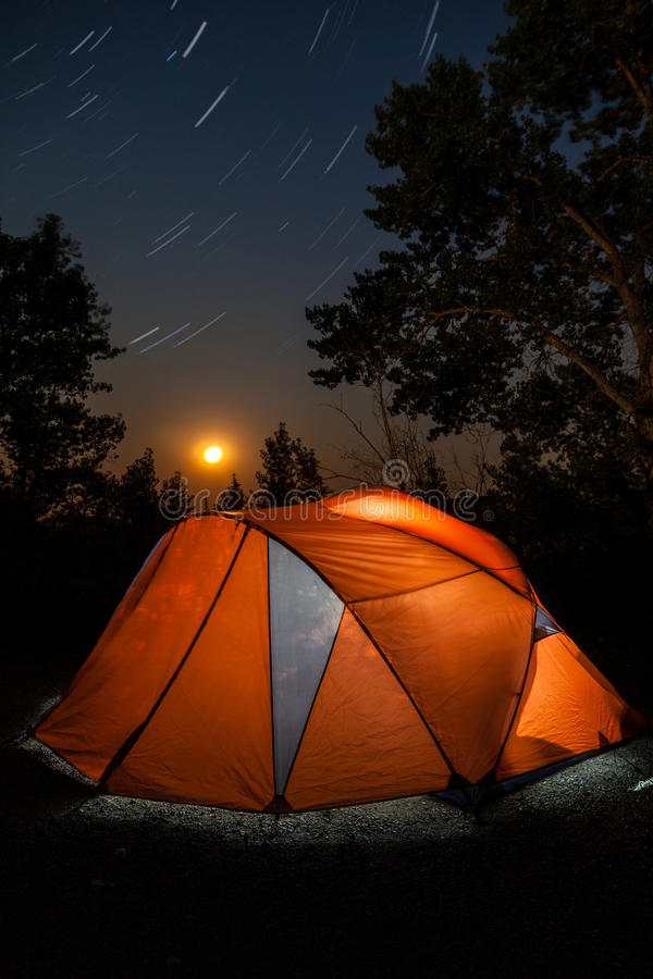 Camping Tent Under Star Trails and Rising Moon royalty free stock image