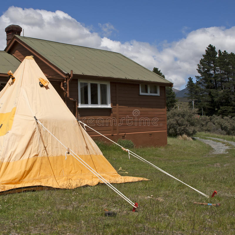 Camping Tent And Wooden Hut In The Mountains Stock Images