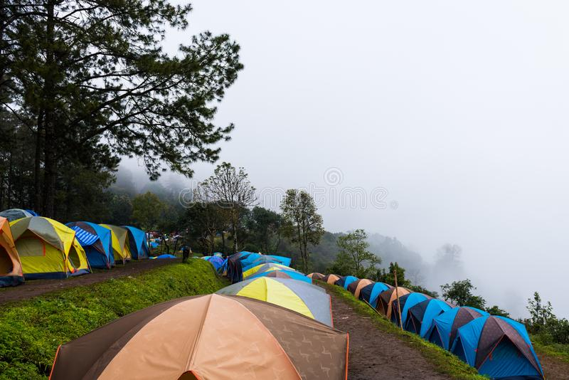 Camping tents with white fog. On mountain royalty free stock image