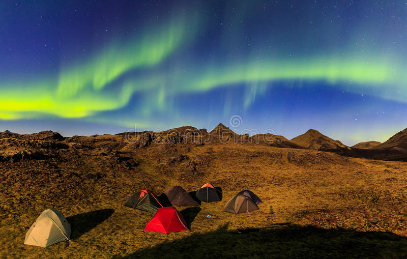 Camping under aurora. Auroraborealis above camp area in the wild nature, Iceland stock image