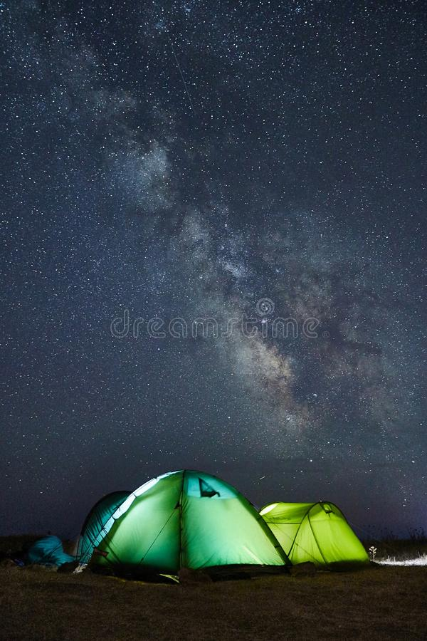 Download Camping Under The Stars With Green Illuminated Tents, Visible Milky Way Galaxy, Clear Sky, Long Exposure Stock Photo - Image of background, desert: 103806376