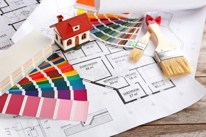 Campioni della tavolozza di colore, modello della casa e spazzole illustrazione di stock