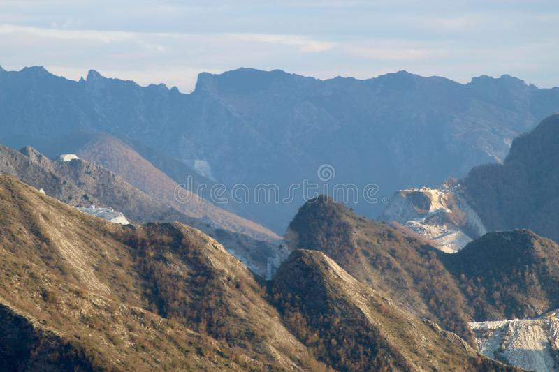 The marble mountains in Italy. This is Campo Cecina in Tuscany , Italy. These are the mountains of the marble. It is really on top of the beautiful mountains stock photography