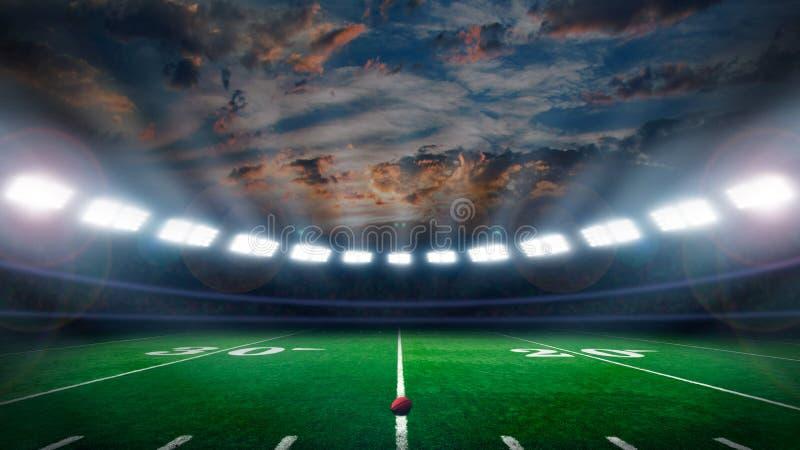 Campo de fútbol con las luces del estadio fotos de archivo