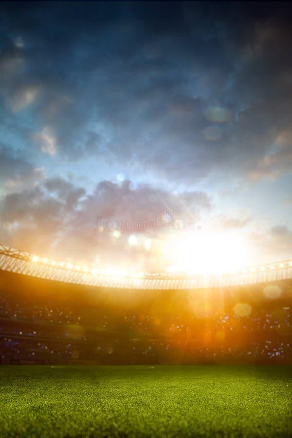 Campo de fútbol de la arena del estadio de la tarde fotos de archivo