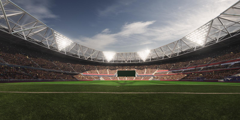 Campo de futebol da arena do estádio da noite fotografia de stock royalty free