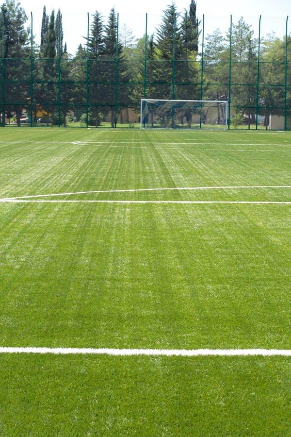 Campo de grama para o futebol fotografia de stock royalty free